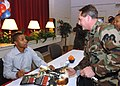 US Navy 060117-N-6996K-002 Actor Cuba Gooding Jr. sign an autograph for Master Chief Master Diver James Mariano.jpg