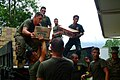 US Navy 060224-N-4772B-243 U.S. Marines assigned to the 31st Marine Service Support Group (MSSG) work together with Philippine Marines loading supplies into a truck in support of relief efforts after a massive Feb. 17 landslide.jpg