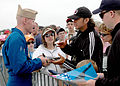 US Navy 060429-N-4657D-025 Lt. Anthony Walley, the number two pilot for the Navy Flight Demonstration Squadron signs autographs.jpg