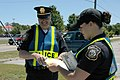 US Navy 060523-N-2456S-200 Two members of the Amphibious Base Little Creek (NABLC) Police Department, tally the number of tickets they issued to drivers who violated traffic laws during the base-wide.jpg