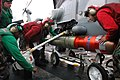 US Navy 061117-N-3136P-119 Sailors assigned to Helicopter Anti-Submarine Light Squadron Five One (HSL-51), load an Mk-46 anti-submarine torpedo onto a SH-60B Seahawk helicopter on the flight deck of USS Kitty Hawk (CV 63).jpg
