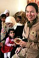 US Navy 061128-M-8213R-019 U.S. Navy Lt. Bundy-Ladowicz, assigned to 3rd Marine Aircraft Wing Forward (3rd MAW (FWD)), enjoys chie (tea) and bread during an Iraqi Woman's Engagement.jpg