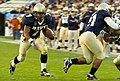 US Navy 061202-N-0696M-712 Navy Midshipmen running back Reggie Campbell (7), form Sanford, Fla., sprints into the end-zone for the Naval Academy's first touchdown of the day, during the 107th playing of the Army vs. Navy footba.jpg