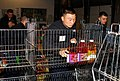 US Navy 070117-N-1831S-025 Storekeeper 3rd Class Young Kim, assigned aboard the amphibious transport dock USS Nashville (LPD 13), stocks a cart with food items at the South Eastern Hampton Roads Food Bank.jpg
