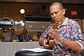 US Navy 070504-N-0775Y-057 Chief Equipment Operator Sean Martin, a Seabee attached to Naval Mobile Construction Battalion (NMCB) 3, plays his Hawaiian ukulele during the Asian Pacific American Heritage celebration.jpg