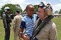 US Navy 070622-N-4238B-064 Capt. Bob Kapcio, Comfort mission commander, holds a young boy from Belize City, Belize.jpg