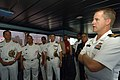 US Navy 070902-N-0989H-062 Cmdr. Rob Morrison, commanding officer of High Speed Vessel (HSV 2) Swift, discusses the ship's capabilities with Vice Adm. Julio Cesar Bayonet, Chief of Staff of the Dominican Republic Navy.jpg