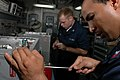 US Navy 070909-N-1332Y-140 Aviation Electronics Technician 1st Class Julio Suazo, right, and Aviation Electronics Technician 3rd Class James Pizzato check aviation equipment in the radar test work center aboard USS Kitty Hawk (.jpg