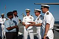 US Navy 070918-N-3255B-009 Capt. Nicholas Holman, commander of Southeast Africa Task Group 60.5, and Cmdr. Dean Vesely, commanding officer of USS Forrest Sherman (DDG 98) lead Mozambique's Chief of Naval Operations and st.jpg