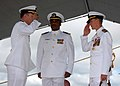 US Navy 080104-N-9758L-137 Capt. William Kearns III, commodore, Destroyer Squadron (DESRON) 31, salutes Capt. Robert Stewart as he officially takes command during a change of command ceremony for DESRON-31 held on board Naval S.jpg