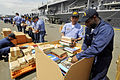 US Navy 090219-N-7280V-135 Armed Forces of the Philippines Navy and Sailors unload pallets of Project Handclasp donated medicine, books, and toys.jpg