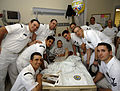 US Navy 090428-N-2570W-003 Sailors assigned to the Los Angeles-class fast-attack submarine USS Toledo (SSN 769) spend time with a patient at the Chris Evert Children's Hospital at Broward General Medical Center.jpg