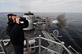US Navy 090627-N-7092S-223 Fire Controlman 2nd Class Eric Brown stands safety watch aboard the guided-missile frigate USS Kauffman (FFG 59) during live-fire exercises off the coast of Chile as part of the Chilean-hosted naval e.jpg
