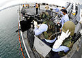 US Navy 090812-N-7498L-125 Sailors aboard the guided-missile destroyer USS O'Kane (DDG 77) defend the ship during the Paulele Palulu (PAPA) '09 anti-terrorism field training exercises.jpg