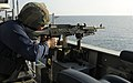 US Navy 091227-N-1291E-214 A Sailor aboard the guided-missile cruiser USS Chosin (CG 65) conducts target practice with an M240B machine gun.jpg
