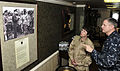 US Navy 100216-N-3595W-001 Capt. Dee L. Mewbourn, commanding officer of the aircraft carrier USS Dwight D. Eisenhower (CVN 69), shows items displayed in the inport cabin to Rear Adm. Karen Flaherty.jpg