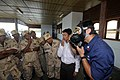 US Navy 100217-N-8335D-172 Damage Controlman 1st Class Arturo Chavez, assigned to the mine counter-measures ship USS Patriot (MCM 7), instructs Royal Cambodian Navy officers how to don an MCU-2P gas mask.jpg