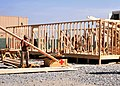 US Navy 100406-N-1133S-471 Seabees assigned to Naval Mobile Construction Battalion (NMCB) 133 build a Southwest Asia hut in Kandahar, Afghanistan.jpg