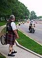 US Navy 100528-N-8366W-162 A Scottish drummer from the Rolling Thunder motorcycle organization watches as riders enter the National Naval Medical Center during a Memorial Day tribute to wounded warriors recovering at the hospit.jpg