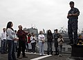 US Navy 100601-N-7058E-027 Chief Damage Controlman Craig Cole welcomes family members aboard USS Freedom (LCS 1).jpg