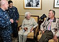 US Navy 100714-N-6632S-071 Former President George H.W. Bush and his wife, Barbara, talk with Capt. Chip Miller, commanding officer of the aircraft carrier USS George H.W. Bush (CVN 77), in the captain's in port cabin.jpg