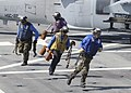 US Navy 100720-N-3154P-017 Sailors remove the chocks and chains from an MH-60S Sea Hawk helicopter assigned to Helicopter Sea Combat Squadron (HSC) 22 aboard the amphibious transport dock ship USS Ponce (LPD 15).jpg