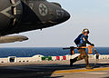 US Navy 110202-N-5538K-051 Aviation Boatswain's Mate Airman Heath R. Johnson removes a grounding gear from an AV-8B Harrier jet aircraft.jpg