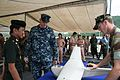 US Navy 110515-N-WL717-103 Lt. Nels Peterson explains how unmanned aerial vehicles are used during riverine operations to Royal Thai Army Gen. Sony.jpg