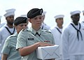 US Navy 110518-N-YM863-133 Spc. Heather Correll holds remains to be committed to the sea during a burial at sea ceremony aboard the amphibious tran.jpg