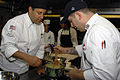 US Navy 110810-N-CL698-022 Michael Harants, left, corporate chef for Navy Family Support, Naval Supply Systems Command, instructs Culinary Speciali.jpg