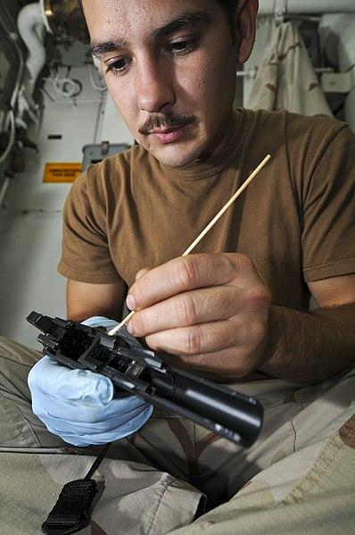 File:US Navy 110815-N-YM590-047 Sailors from the VBSS team clean weapons.jpg