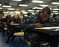 US Navy 110908-N-PQ745-011 Aviation Boatswain's Mate (Handling) 3rd Class Dominick Poindexter takes the Navy-wide E-5 advancement exam.jpg