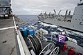 US Navy 111116-N-DX615-014 Aviation Boatswain's Mate (Fuels) Airman Quinton Smith watches a fuel probe from the Military Sealift Command dry cargo.jpg