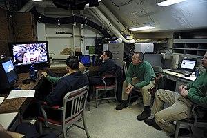 US Navy 120205-N-VA840-076 Sailors watch Super Bowl XLVI aboard USS George H.W. Bush.jpg