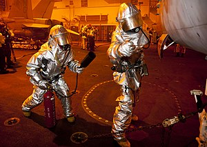 US Navy 120214-N-BT887-148 Sailors check an aircraft for a simulated fire during a general quarters training exercise aboard the Nimitz-class aircr.jpg