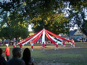 English: Students perform maypole dance, as th...