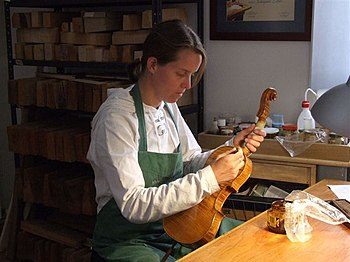 Varnishing a violin by Hildegard Dodel, luthie...