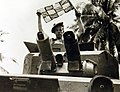 Vehicle crew member putting up a signal, Argyll and Sutherland Highlanders, Malaya, WWII (24522052486).jpg
