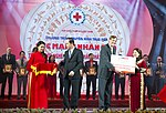 Vietnam's State President Tran Dai Quang Recognizes USAID's Disaster Relief Assistance (38675362795).jpg