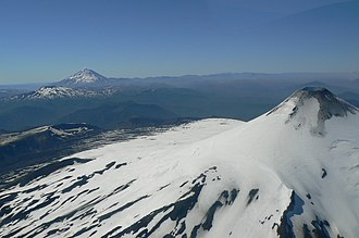Zona Sur - Aerial view of the volcanic alignment of Villarrica, Quetrupillán and Lanín.