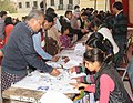 Voters identifying their name in voter list, at a polling booth, during the Delhi Assembly Election, in Delhi on February 07, 2015.jpg