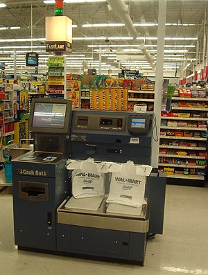 A picture of one of Wal-Mart's Self-Checkout l...