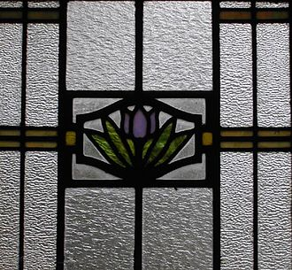 William J. Dodd - Art glass window with tulip-lotus on water motif. T. Hoyt Gamble House, Louisville, KY (1912)
