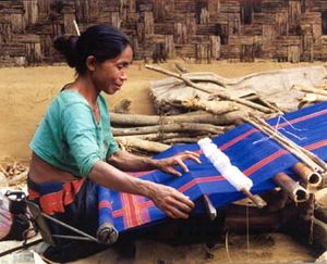 A woman weaving. Textile work has historically...