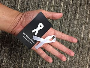 White ribbon - A white ribbon given out by the Association of Women for Action and Research in Singapore during White Ribbon Week 2015, a campaign opposing violence against women