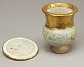 Wide-necked jar and lid naming Thutmose III MET 26.8.34ab.back.jpg