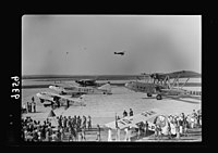 Wings over Palestine-Certificates of Flying School, April 21, 1939. Lydda runway showing air liners, etc., & test plane just taken off (Lydda Air Port) LOC matpc.18304.jpg