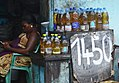 Woman selling refined palm oil.jpg