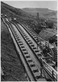 """Roller bearings for belt conveyor leaving gravel screening plant."" - NARA - 294131.tif"
