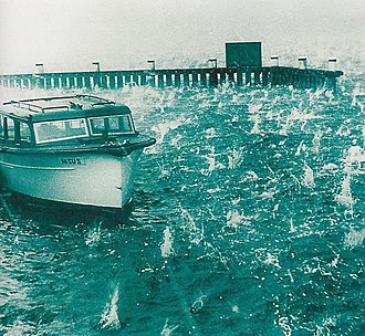 1947 Sydney hailstorm - A boat at Rose Bay in water which is being churned by the hailstones.